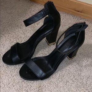 Gold Tipped Black Heel